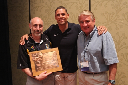 Dr. Ira A. Shapiro (left), director of the Plaza Chiropractic Center was elected a fellow of the International College of Chiropractors (FICC) during ceremonies held during the most recent meeting of the American Chiropractic Association (ACA) Council on Sports Injuries & Physical Fitness. Presenting the honor to Shapiro was Dan O'Brien (center), the 1996 Olympic gold medalist in the decathlon, and Dr. Philip T. Santiago (right), secretary general of the Federation Internationale de Chiropatique du Sport (FICS).