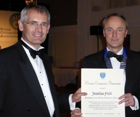 Field (Left) receiving his award from Matthew Bennett the new President of the British Chiropractic Association.