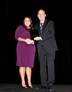 Jenny Mejia, DC, receives DC of the Year Award.