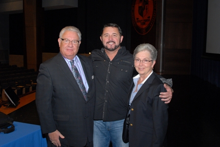 Logan College President Dr. George Goodman (left) and Dr. Elizabeth Goodman with Dr. Howard Wasdin. Credit: Cliff Pollack
