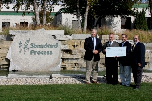 Jefferson County representatives accept a $5,000 endowment check from Standard Process Inc. to support Jefferson County parks. Pictured left to right are Joe Nehmer, Jefferson County Parks director; Charles C. DuBois, president of Standard Process; Charles Luthin, Natural Resources Foundation of Wisconsin executive director; and John Molinaro, Jefferson County Board chairman.