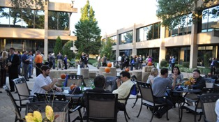 Alumni and Friends gather in the courtyard during reception
