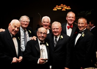 Shown left to right are previous Brilliant Star Award winners Dr. Victor Marty; Dr. John Allenberg; Dr. Sawyer; Dr. Joseph Sweere; Dr. Jack Holtz; Dr. Mark Zeigler; and Charles DuBois.