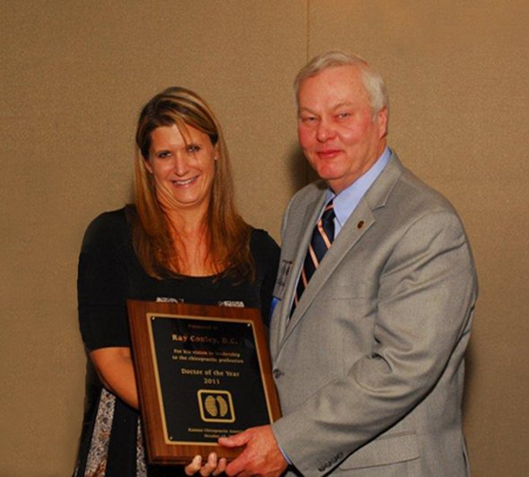 Dr. Conley, right, accepts his 'Doctor of the Year' award.