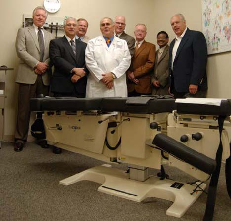 (from left): Dr. Tom Milus, Palmer's West Campus; Drs. James Owens, Larry Swank and Dennis Lopez from the Academic Health Center Clinic on Palmer's Davenport Campus; Dr. Kurt Wood, Palmer's Vice Chancellor for Clinic Affairs; Dr. James M. Cox; Dr. Ram Gudavalli and Mr. Don Wisner, President of Haven Innovation.